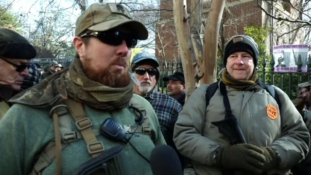 pro-gun rally in virginia; usa: virginia: richmond: ext gv activists wearing helmets gv activists gathered on steps outside government building gv... - political rally stock videos & royalty-free footage