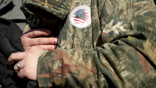 pro-gun stickers are seen on the jacket of a gun rights advocate during a rally organized by the virginia citizens defense league on capitol square... - virginia us state stock videos & royalty-free footage
