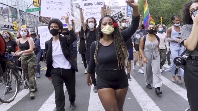 pro-immigrant and anti-police demonstrators march on the streets of downtown manhattan on september 27, 2020 in new york city. activist call for the... - アメリカ移民税関捜査局点の映像素材/bロール