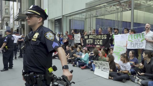 proimmigration activist blocked the entrance of the microsoft store fifth avenue in manhattan new york city the same group later stopped vehicular... - department of homeland security stock videos & royalty-free footage