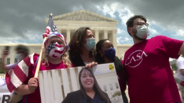 pro-immigration activists gather outside the us supreme court in washington after it rejected us president donald trump's cancellation of the daca... - emigration and immigration stock videos & royalty-free footage