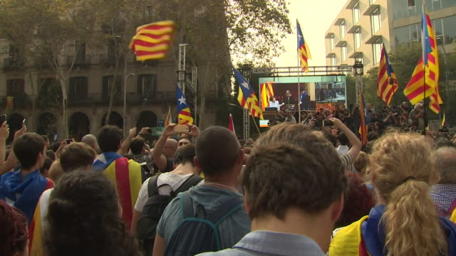 Proindependence supporters cheering and celebrating as the Catalonia parliament votes for independence from Spain