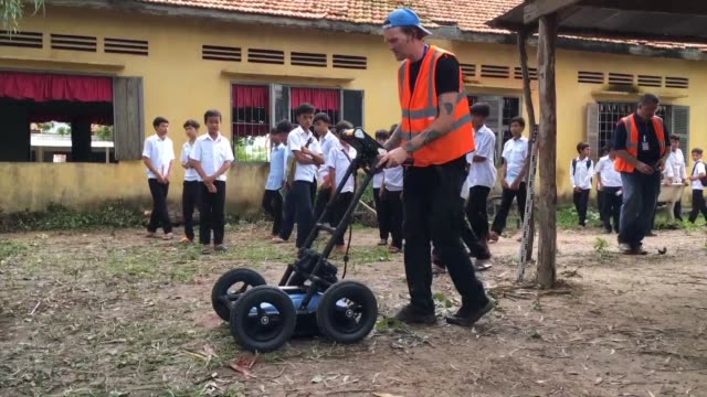 a project in cambodia is using ground penetrating radar to unearth clues of mass graves linked to the khmer rouge the ultra maoist regime whose quest... - maoism stock videos & royalty-free footage