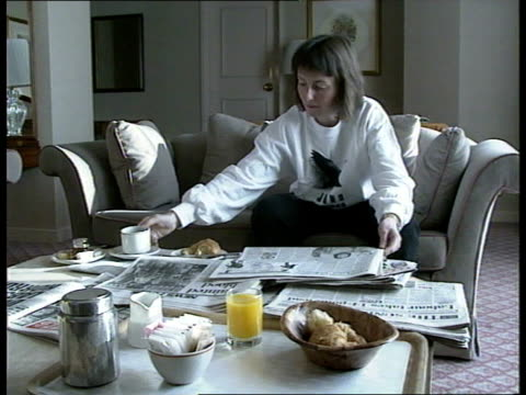 mission candidate helen sharman profile:; england: london: int helen sharman reading morning papers and drinking coffee in hotel room; - morning stock videos & royalty-free footage