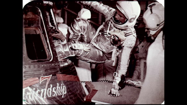vídeos y material grabado en eventos de stock de project mercury astronaut john glenn enters the mercuryatlas 6 friendship 7 spacecraft wearing the full pressure suit and helmet / mcdonnell aircraft... - 1962
