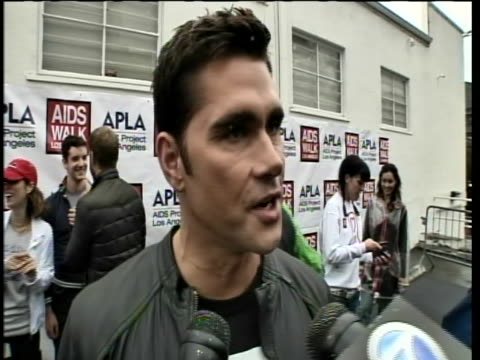 """project runway designer, jack mackenroth, comments on his participation at the 2010 los angeles aids walk. he says, """"actually, i have been hiv... - retrovirus video stock e b–roll"""