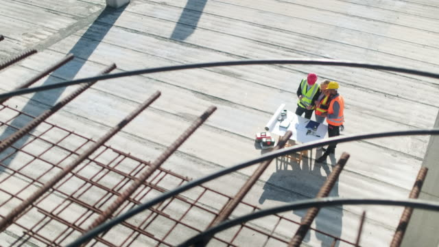 project team surrounded by rebar and reinforced concrete - construction worker stock videos & royalty-free footage