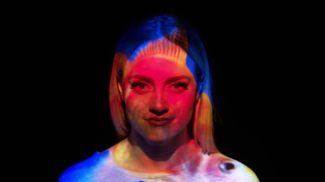 projection of a goldfish on a woman's face - multi coloured stock videos & royalty-free footage
