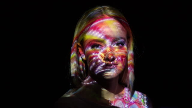 projection of amusement park on a woman's face - projection stock videos & royalty-free footage