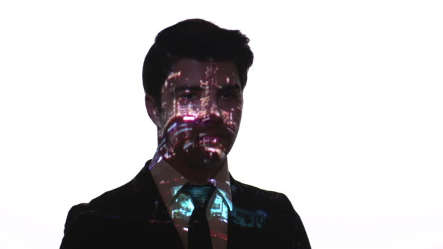 Projection of city lights on a businessman's face