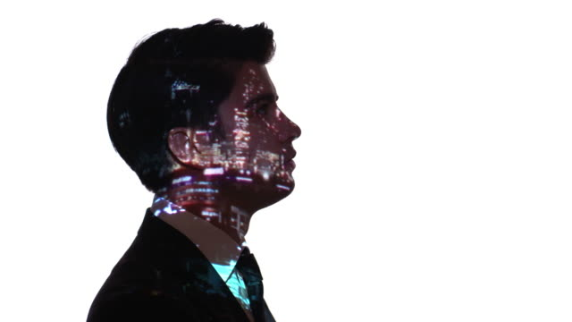projection of city lights on a businessman's face - ethereal stock videos and b-roll footage