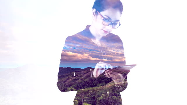 Projection of cloud scape timelapse on a business woman