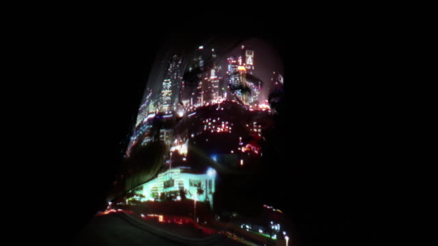 Projection of Dubai city lights on a woman's face