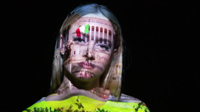 Projection of Emmanuel Monument on a woman's face