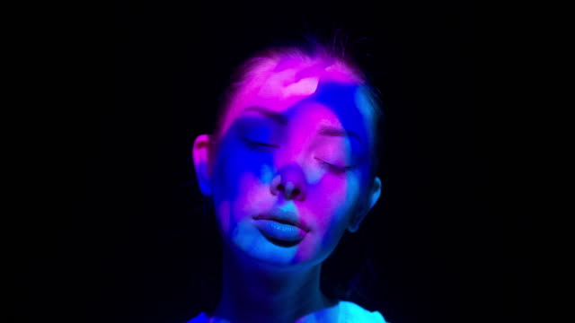projection on a woman's face - colors stock videos & royalty-free footage
