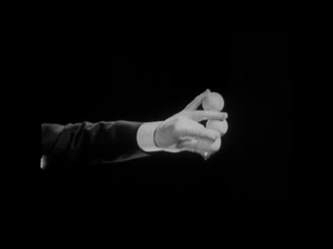 B/W CU 1936 Projection on screen of magician's hand doing trick with balls