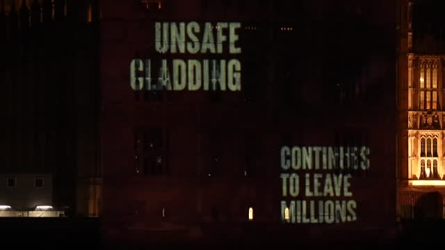 projection on to the houses of parliament calling for the removal of unsafe cladding from tower blocks - fire natural phenomenon stock videos & royalty-free footage