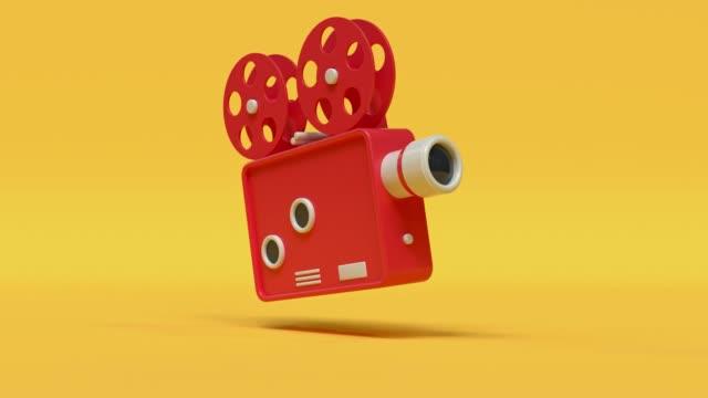 vídeos de stock, filmes e b-roll de projetor máquina vermelho amarelo estilo cartoon minimalista 3d renderização cinema teatro conceito - amarelo