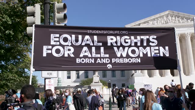 pro-life activist counter protest pro-choice at the u.s. supreme court during the women's march in washington dc on october 17, 2020. participants... - justice concept stock videos & royalty-free footage