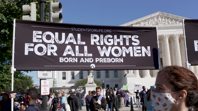 pro-life activist counter protest pro-choice at the u.s. supreme court during the women's march in washington dc on october 17, 2020. participants... - social movement stock videos & royalty-free footage