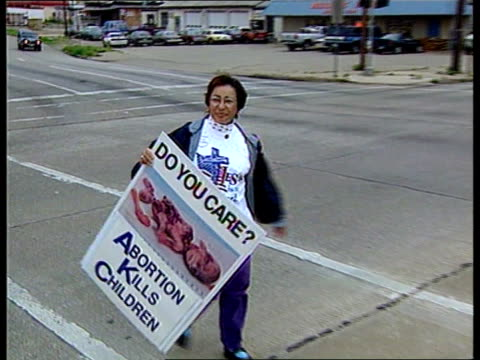 usa texas dallas group of prolife demonstrators praying before starting campaign male campaigner taking large placard out of car campaigners along... - clinic stock videos and b-roll footage