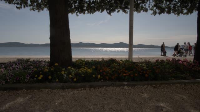 promenade along the adriatic sea, zadar, zadar county, dalmatia region, croatia, europe - adriatic sea stock videos & royalty-free footage