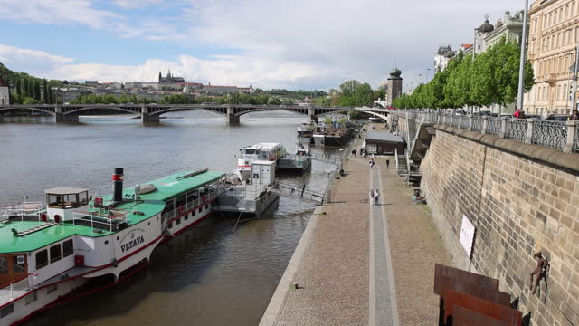 stockvideo's en b-roll-footage met promenade at waterfront while czech republic reopens its cafe and restaurant terraces, in stare mesto, prague, czech republic, on monday, may 17,... - stare mesto
