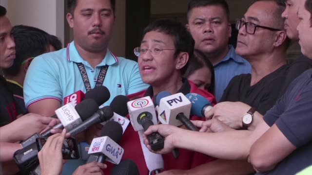 prominent journalist and government critic maria ressa posts bail and leaves a philippine court following a string of criminal charges - bail cricket stump stock videos & royalty-free footage