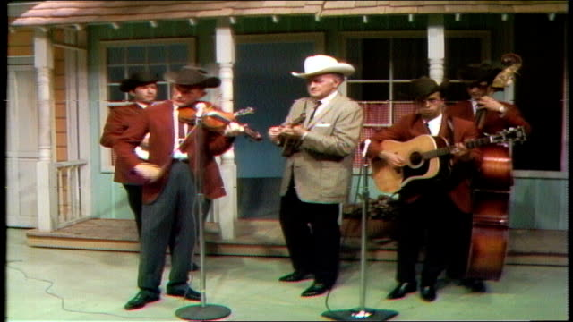"promo for the porter wagoner show bill monroe and the bluegrass boys wearing cowboy hats performing ""train 45 "" porter wagoner wearing rhinestone... - bluegrass music stock videos and b-roll footage"
