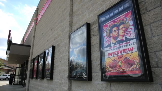 """promotional signs outside jasper 8 theatres american movie theatre where, """"the interview,"""" which sony originally pulled after north korea allegedly... - sony stock-videos und b-roll-filmmaterial"""