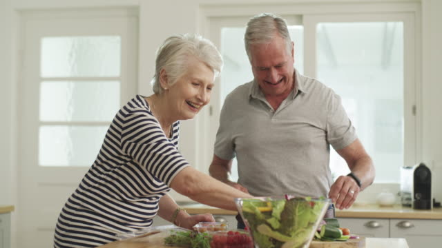proof that eating healthy doesn't have to be complicated - senior couple stock videos & royalty-free footage