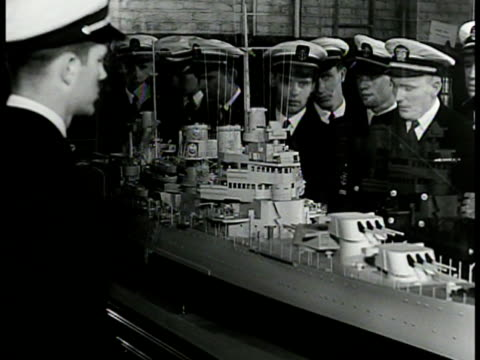 wwii propaganda poster 'become a naval officer' int vs navy cadets looking at model battleship ws cadets in lifesize model of bridge ms cadets on... - 1942 stock videos & royalty-free footage