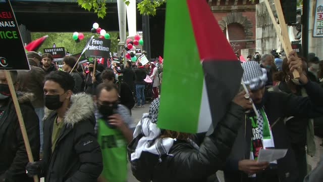pro-palestinian protesters march in london and call for a solution to the israeli-palestinian conflict; england: london: embankment: ext various of... - war and conflict stock videos & royalty-free footage
