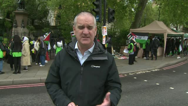 pro-palestinian protesters march in london and call for a solution to the israeli-palestinian conflict; england: london: embankment: ext reporter to... - war and conflict stock videos & royalty-free footage