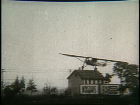 B/W propeller airplane landing Spirit of St Louis