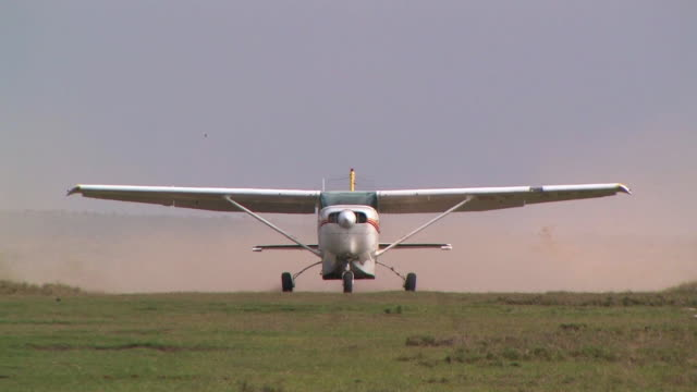 CU, Propeller airplane taking off from grass runway, Laikipia, Kenya