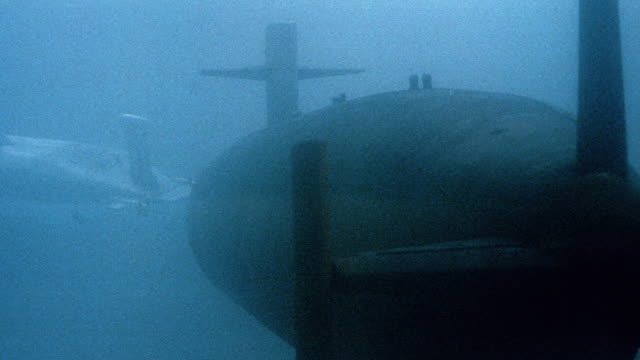 a propeller begins spinning on a nuclear submarine. - propeller stock videos & royalty-free footage