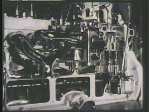 Propeller engine parts on display showing moving gears crankshafts piston rods other engine parts partial propeller turning slowly Modern industry...