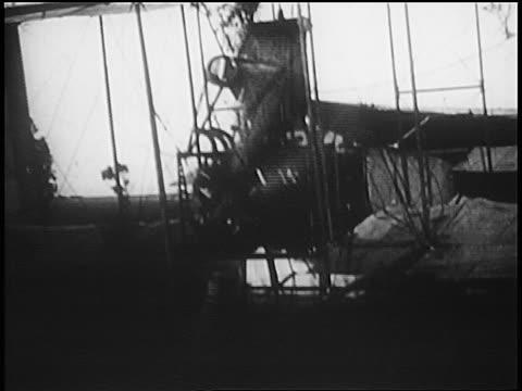 propeller of biplane starting up before flight / australia / newsreel - 1910 stock-videos und b-roll-filmmaterial