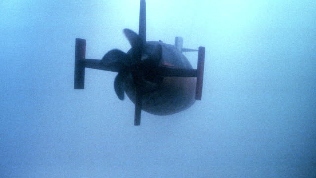 a propeller spins as a nuclear submarine travels through the ocean. - propeller stock videos & royalty-free footage