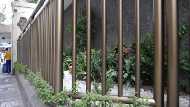 vídeos de stock, filmes e b-roll de property protection fence in the copacabana neighbourhood on november 27, 2019 in rio de janeiro, brazil - cadeira