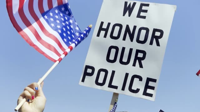 """pro-police and predominantly president donald trump supporters rallied at brooklyn's marine park in support of the nypd . the """"we back the blue""""... - orthographic symbol stock videos & royalty-free footage"""