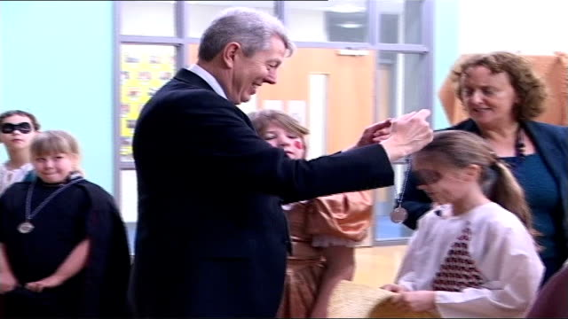 proposals to raise compulsory school leaving age to 18 leicestershire queensmead community primary school alan johnson mp awarding medals to little... - alan johnson stock videos & royalty-free footage