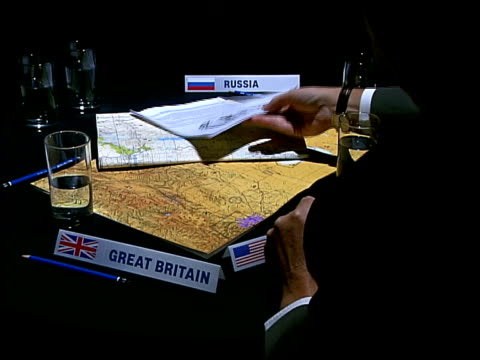 US Proposes new UN resolution ITN London Russia France US China Britain diplomats round table with maps and UN resolutions Dr Martin Navais...