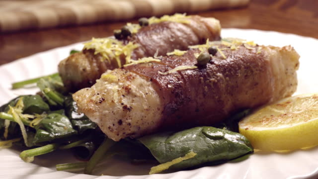 prosciutto di parma ham wrapped cod filets with capers - portuguese culture stock videos & royalty-free footage