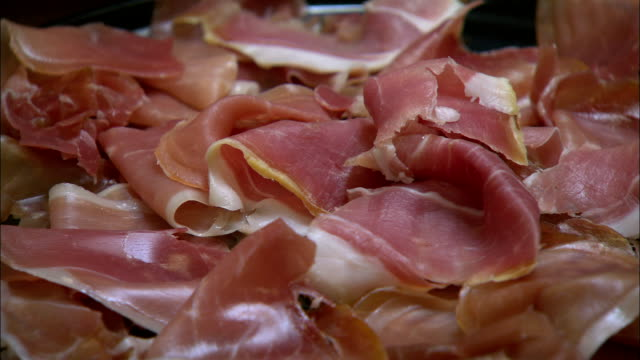 prosciutto is piled on a plate. - slice of food stock videos & royalty-free footage