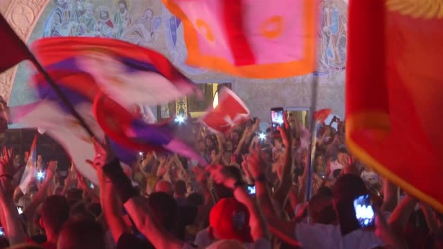 proserb opposition supporters hit the streets of podgorica on monday to celebrate waving serbian flags marching and driving through the city honking... - waving icon stock videos & royalty-free footage