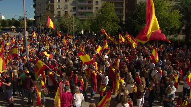 ProSpain demonstrators celebrating outside a military barracks in Barcelona after the government temporarily revoked Catalonia's autonomy