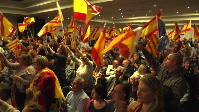 ProSpain supporters cheering Prime Minister Mariano Rajoy on his first visit to Catalonia since sacking the Catalan government