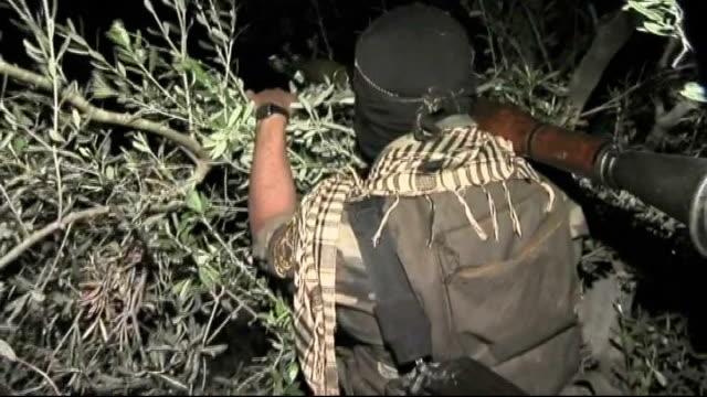 Islamist Jihad member talking to others Islamist Jihad members holding guns Militant member running along Militant member hiding in bush Militant...